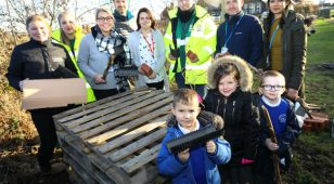 In a bid to give back to nature, two major businesses have joined forces with a village primary school in South East Northumberland to build a bug hotel in the school's grounds.