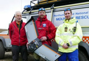 Photo caption (L to R) : Brian Allport and Stuart King from Northumberland National Park Mountain Rescue Team with Adam Turner, observer and Senior Coastal Operations Officer at H.M. Coastguard pictured with the fixed wing drone used in Exercise Northumberland.