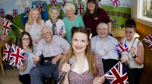 Hay Days launch at Whitehouse Farm with vintage singer Kayley Cares (centre), Dawn Peters, Whitehouse Farm events coordinator (back right) and the team from the assisted living & healthcare division of Legrand UK & Ireland with residents from Scarbrough Court Care Home in Cramlington.