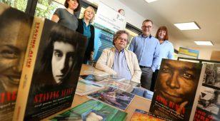 Neil Astley (front centre) and the team from Bloodaxe Books with Northumberland National Park chief executive, Tony Gates (second from right).