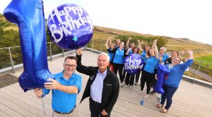 On top of the world! The Sill team celebrate the Centre's first anniversary from the roof top (foreground L to R) Tony Gates, Northumberland National Park Authority Chief Executive with Chairman Glen Sanderson.