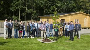 A tree is planted at the new Woodland Centre at Kirkley Hall to commemorate the launch of the Northumbria Veteran Tree Project.