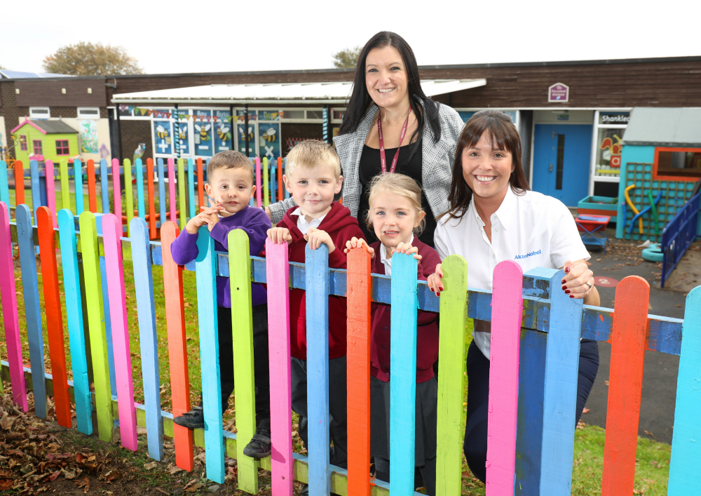 Early years manager, Kay Laughton and pupils from Shanklea Primary School with Jill Johnston, site support coordinator from AkzoNobel Ashington in the refreshed playground.