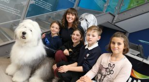 Site support coordinator Jill Johnston with children and Dulux dog