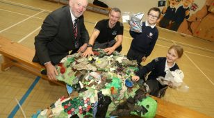 Councillor Malcolm Peden with Paul Mordue from Wild About Adventure and pupils from Bothal Primary School photographed with 'Tallulah' the sea turtle.