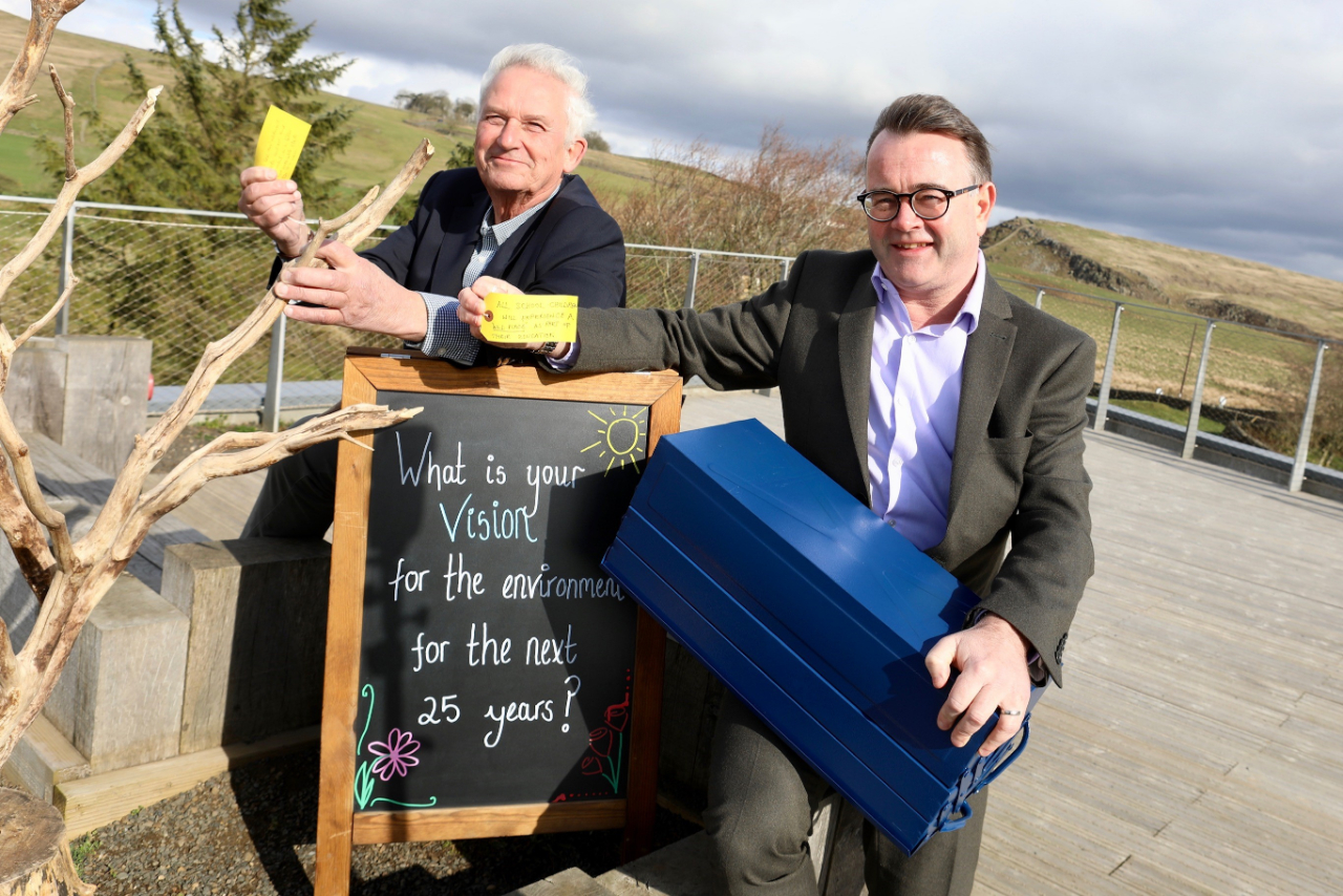 Chairman of Northumberland National Park, Councillor Glen Sanderson and Chief Executive, Tony Gates with the time capsule that is to be buried at The Sill.