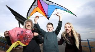 Sheila Harrison, organiser of Newbiggin Kite Festival with young enthusiast, Charlie Stoddart-Gallacher (10), and Janet Mole of Lynemouth Power Station.