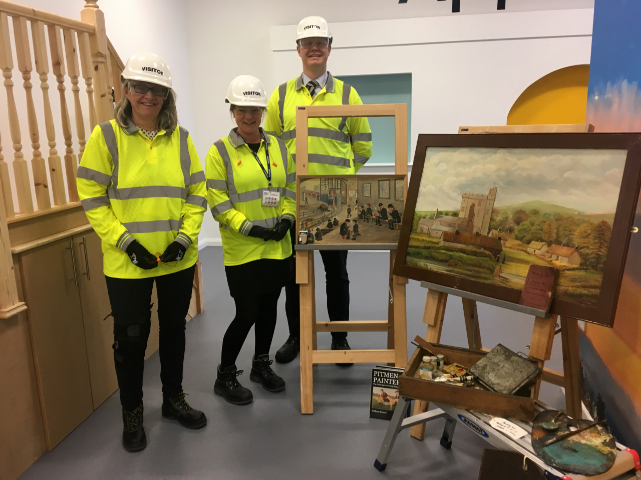 (L to R) Lieke Conijn, Nanja Piek and Martijn Verwegen from The Embassy of the Netherlands in London with the artworks by the Ashington Group, 'Pitmen Painters'.