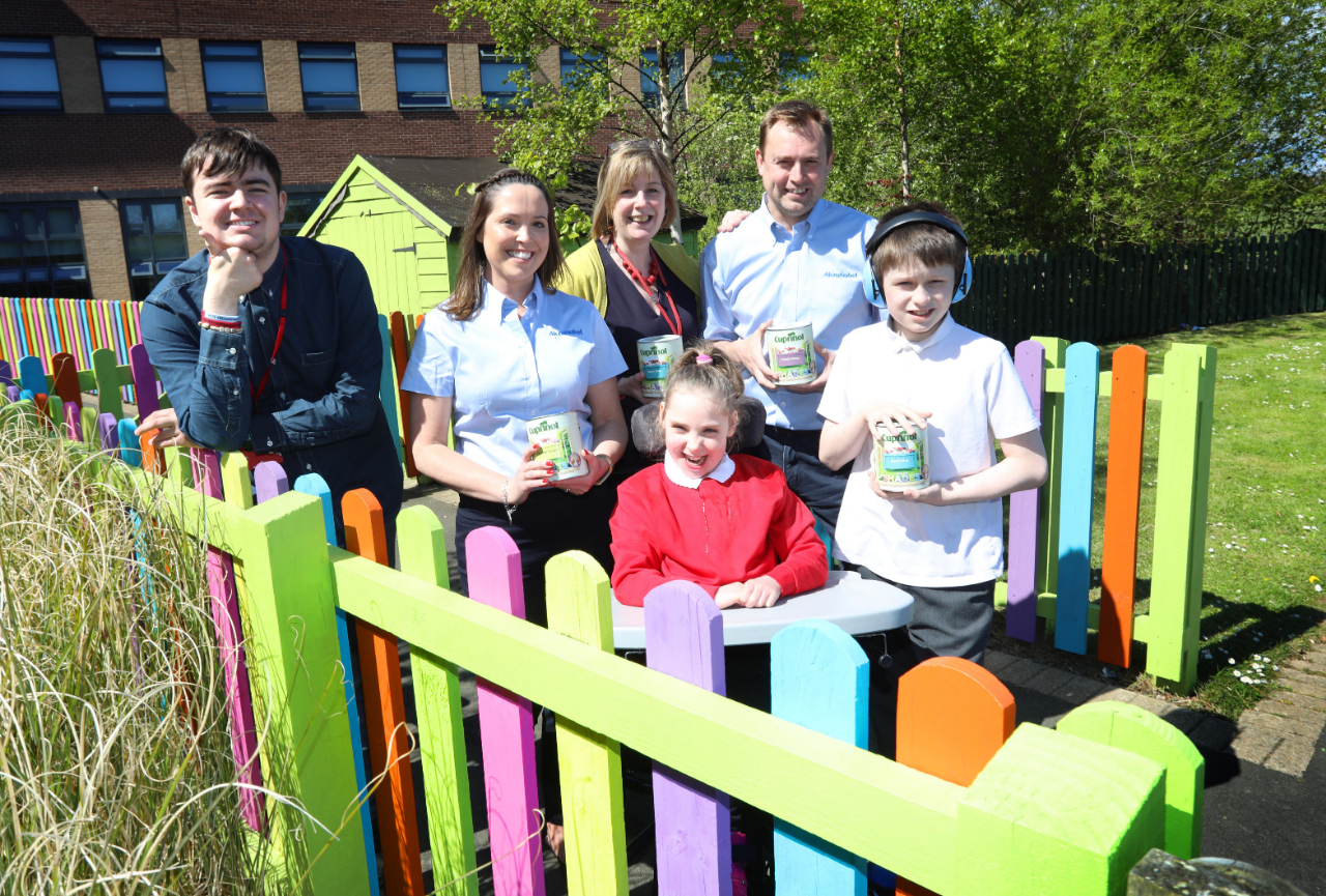 Jill Johnston and Jeff Hope from AkzoNobel Ashington with headteacher, Sara Wild and pupils from Castle School.