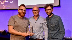 Ed Hudspeth and Andrew Mitchell from Northumberland National Park are presented with the Community Engagement Customer Success Award at the ESRI Annual Conference.