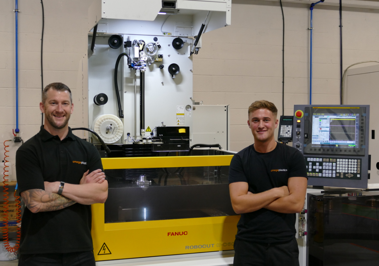 Toolmaker, Martyn Musgrave with Luke McMorris, Apprentice Toolmaker at Omega Plastics with the new Fanuc ROBOCUT wire EDM machine.