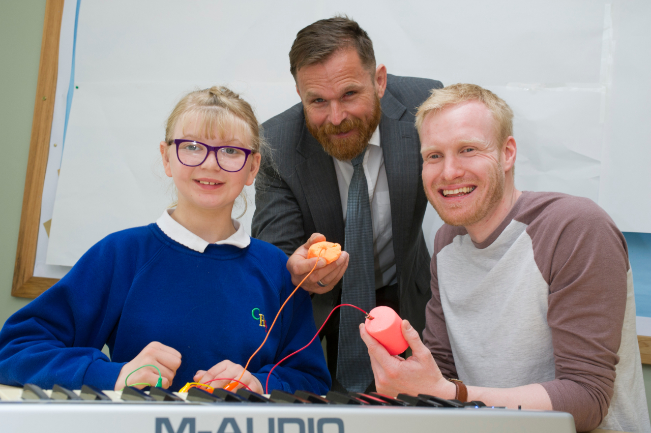 Cleaswell Hill School pupil, Emily Bone, with Headteacher, Mike Jackson and Tom Rand.